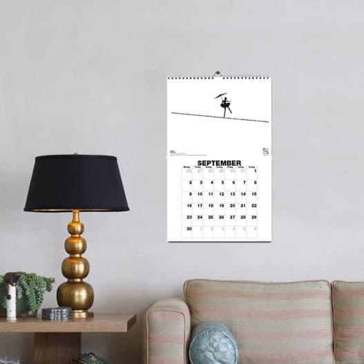 """Flot vægkalender med 12 af Kim Larsens store hits. Her er vist teksten til """"Om lidt"""""""